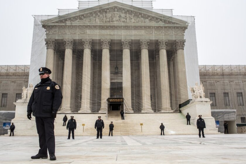 Police officers guard the plaza in front of the Supreme Court as anti-abortion protesters hold the March for Life in Washington.