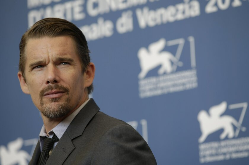 Actor Ethan Hawke poses for photographers during the Good Kill photo call, the 71st edition of the Venice Film Festival in Venice, Italy, Friday, Sept. 5, 2014. (AP Photo/Andrew Medichini)
