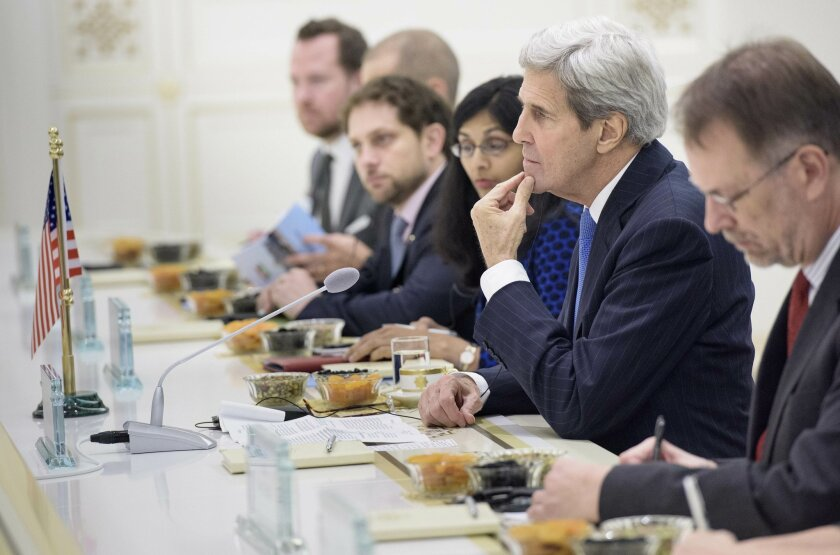 US Secretary of State John Kerry, 2nd right, listens to an opening statement by Turkmen President Gurbanguly Berdimuhamedov (not seen) before a meeting at the Oguzkhan Presidential Palace in Ashgabat, Turkmenistan Tuesday, Nov. 3, 2015. (Brendan Smialowski/Pool Photo via AP)