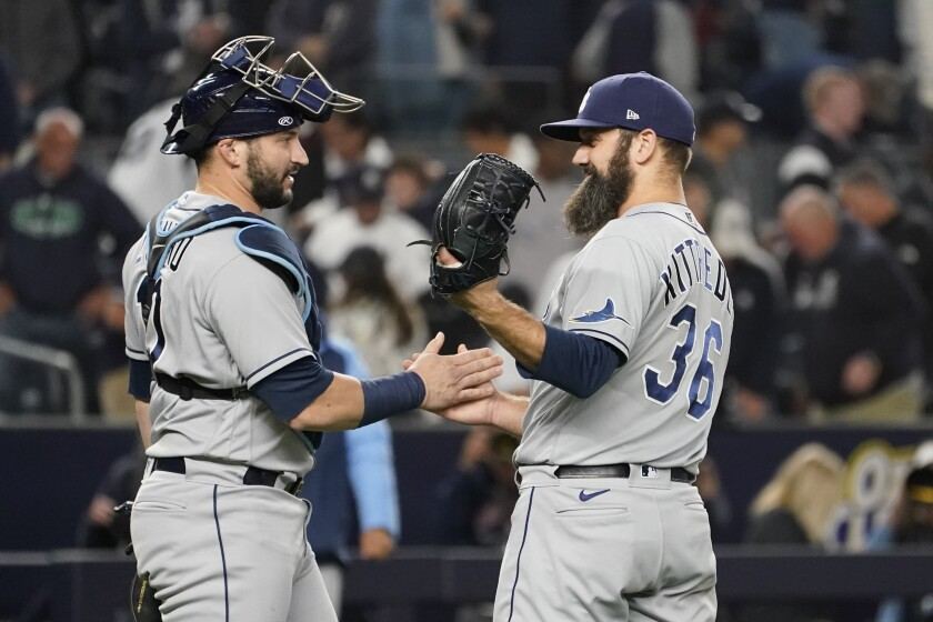 Tampa Bay Rays pitcher Andrew Kittredge (36) and catcher Francisco Mejia celebrate after they defeated the New York Yankees in a baseball game, Friday, Oct. 1, 2021, in New York. The Rays won 4-3. (AP Photo/Mary Altaffer)