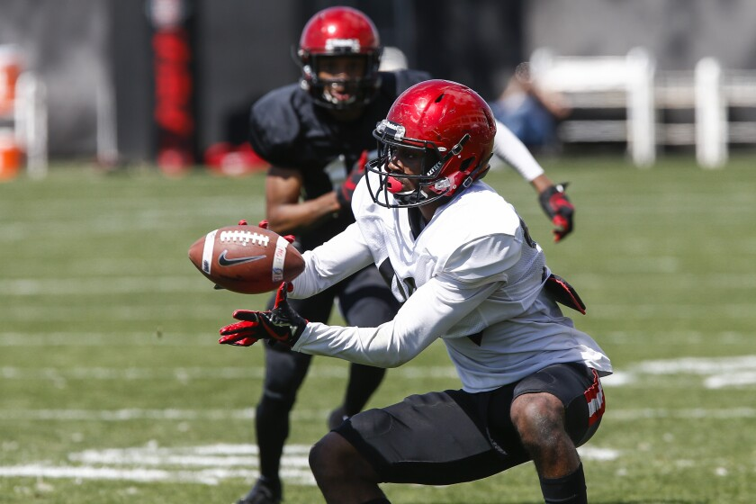 Aztecs wide receiver Kobe Smith catches a pass in the first half.