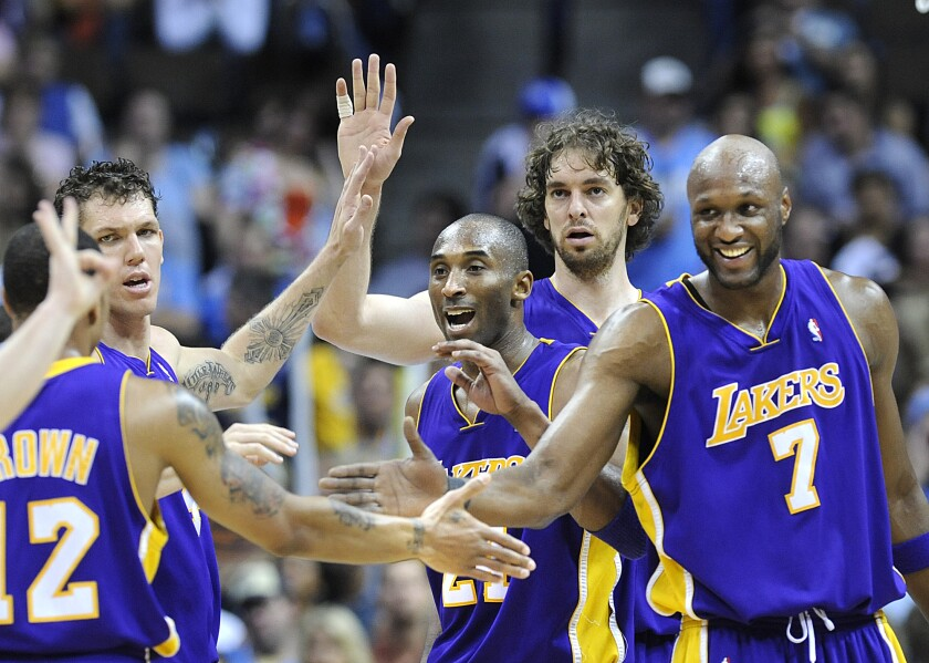Lakers teammates (from right) Lamar Odom, Pau Gasol, Kobe Bryant and Luke Walton congratulate Shannon Brown after he made a key basket against the Nuggets in Game 6 of the Western Conference finals.