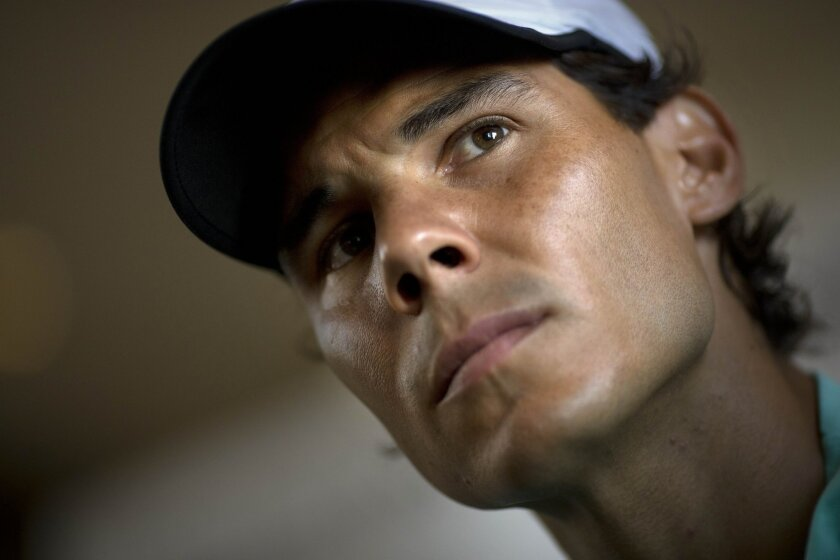 Spain's tennis player Rafael Nadal listens to a question during a press conference in Buenos Aires, Argentina, Monday, Feb. 23, 2015. Nadal will play at the Argentina Open that starts Tuesday. (AP Photo/Rodrigo Abd)