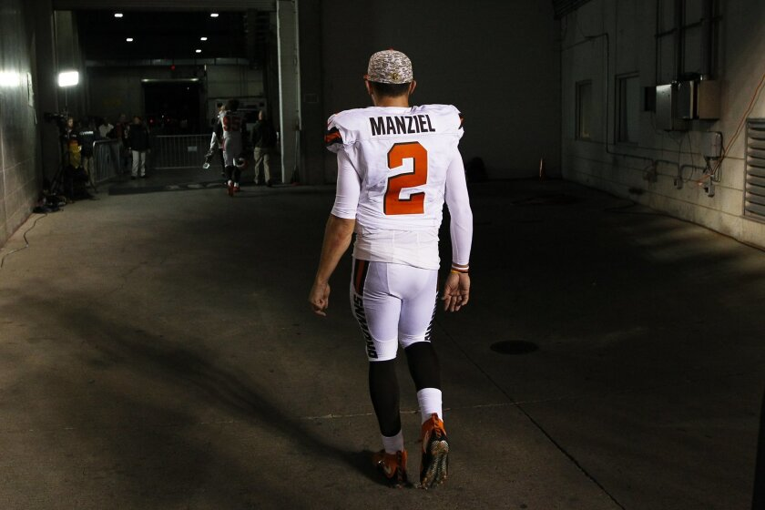 Cleveland Browns quarterback Johnny Manziel walks off the field after an NFL football game against the Cincinnati Bengals, Thursday, Nov. 5, 2015, in Cincinnati. The Bengals won 31-10. (AP Photo/Frank Victores)