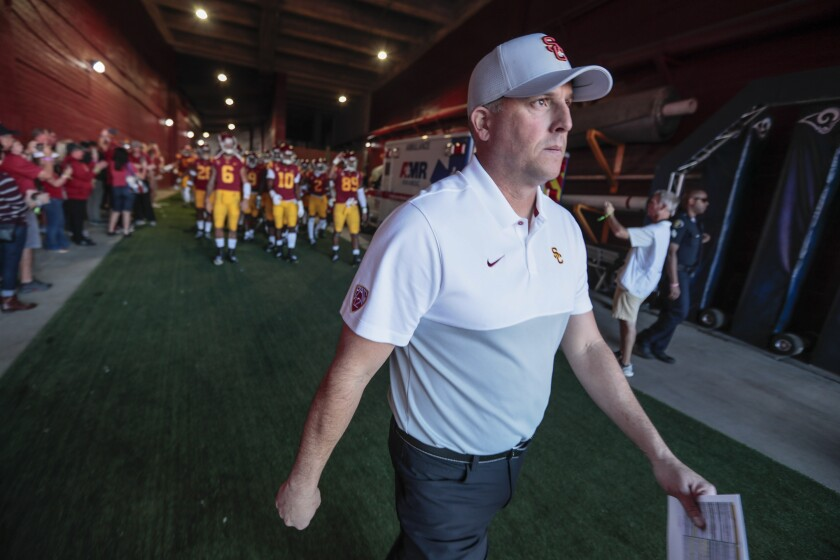 USC coach Clay Helton leads his team out of the tunnel before Saturday's 52-35 win over UCLA at the Coliseum.