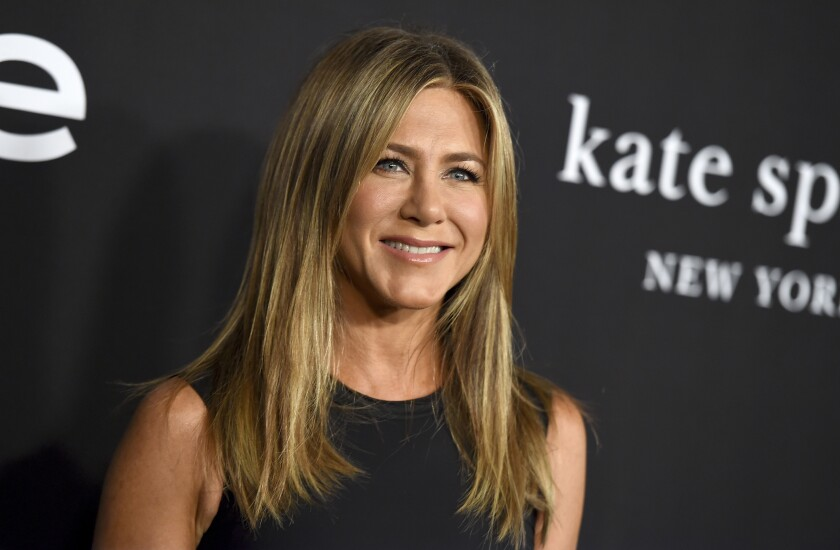 """FILE - Jennifer Aniston arrives at the fourth annual InStyle Awards on Oct. 22, 2018, in Los Angeles. Aniston is among the celebrities taking part in an Aug. 20 virtual reading of the script for 1982's """"Fast Times at Ridgemont High"""" as an online fundraiser. (Photo by Jordan Strauss/Invision/AP, File)"""