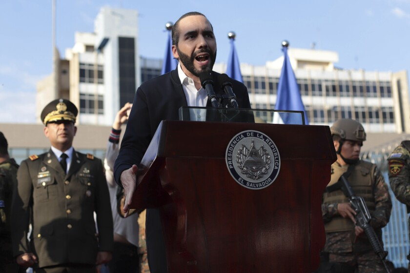 FILE - In this Feb. 9, 2020 file photo, El Salvador's President Nayib Bukele, accompanied by members of the armed forces, speaks to supporters outside Congress in San Salvador, El Salvador. The Biden administration turned down a meeting request with El Salvador's president on an unannounced trip to Washington on the first week of Feb. 2021. (AP Photo/Salvador Melendez, File)