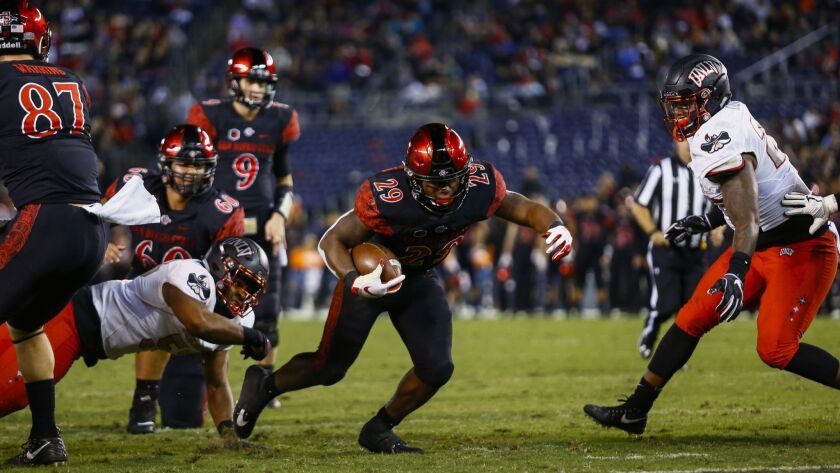 SDSU running back Juwan Washington (29) rushes for a touchdown on fourth down late in the second quarter against UNLV to put the Aztecs on top 14-13.
