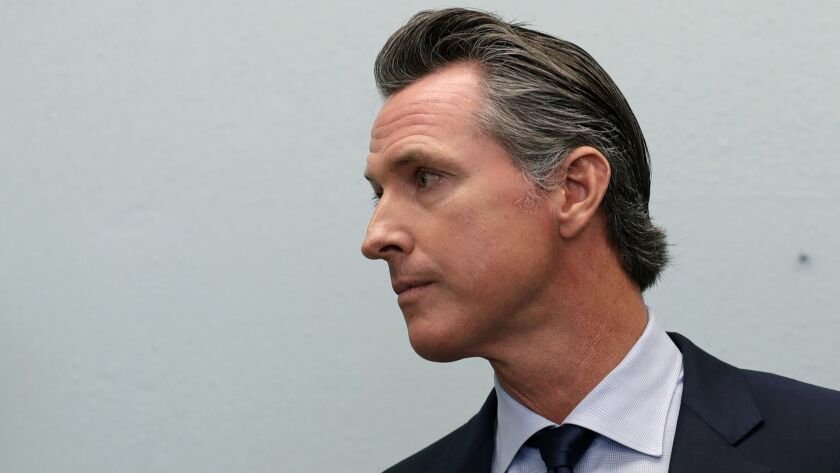 Governor-elect Gavin Newsom looks on during a news conference near the border Thursday, Nov. 29, 201