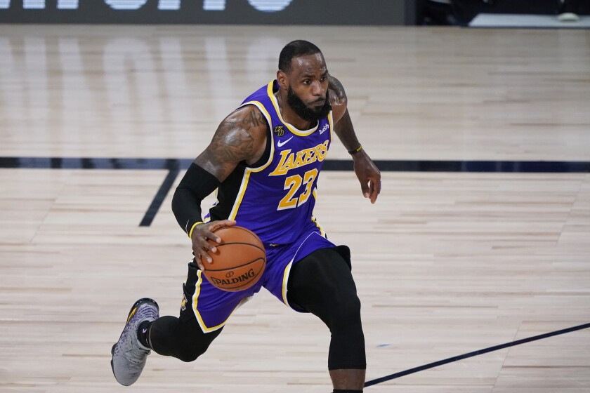 The Lakers' LeBron James drives against Portland during the first half Aug. 22, 2020.