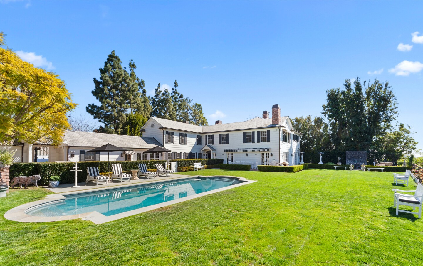 The cul-de-sac compound includes a 1930s home, two-story guesthouse, swimming pool and tiered garden overlooking the Bel Air Country Club golf course.