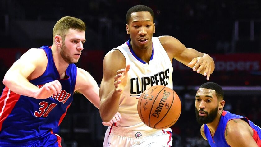 Clippers' Wesley Johnson tries to get past Detroit's Jon Leuer, left, and Andre Drummond on Nov. 7.