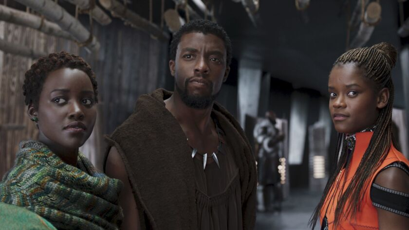 This image released by Disney shows Lupita Nyong'o, from left, Chadwick Boseman and Letitia Wright i