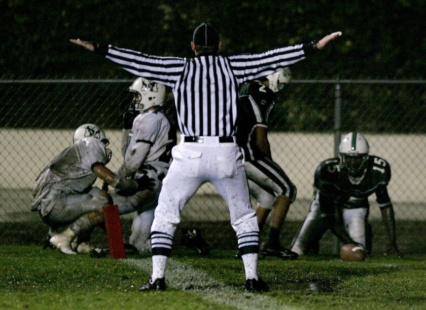 Football officials say they're trained to enforce the rules, not to make medical decisions affecting athletes.