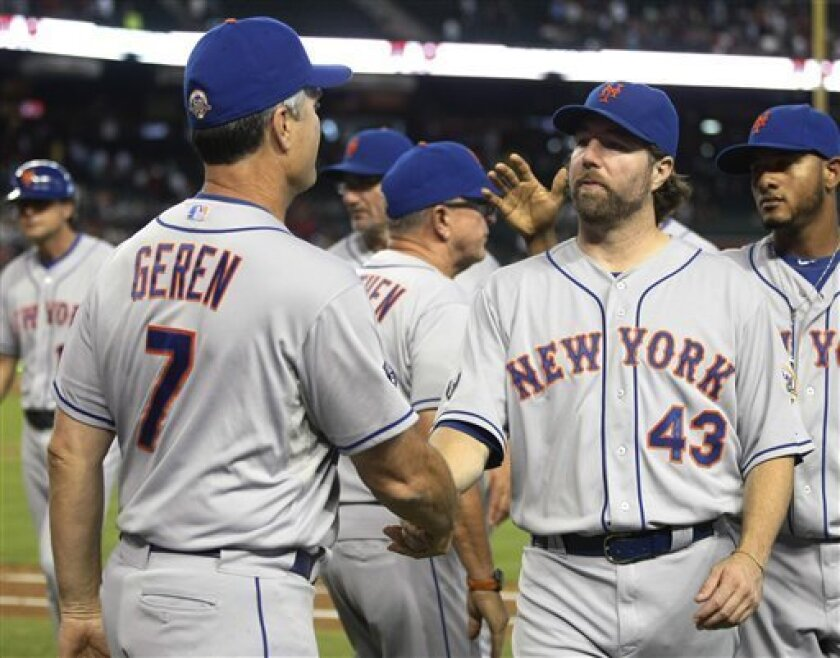 New York Mets R.A. Dickey, right, celelbrates with bench coach Bob Geren after defeating the Arizona Diamondbacks 5-1 during a baseball game on Sunday, July 29, 2012, in Phoenix. (AP Photo/Rick Scuteri)