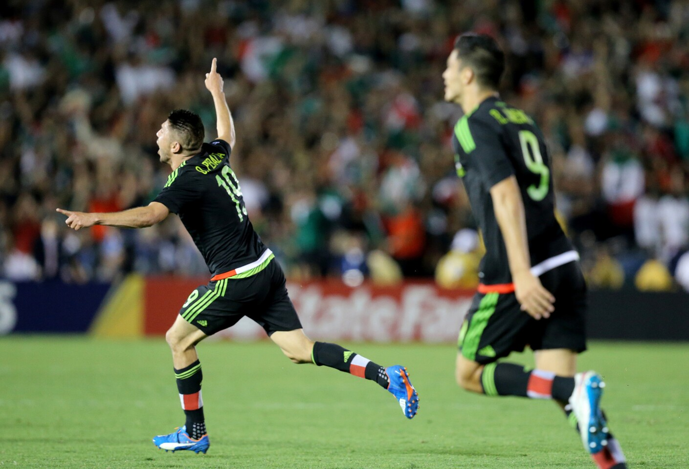 Mexico forward Oribe Peralta celebrates a goal against the U.S. in the first overtime period of a CONCACAF Cup game at the Rose Bowl.