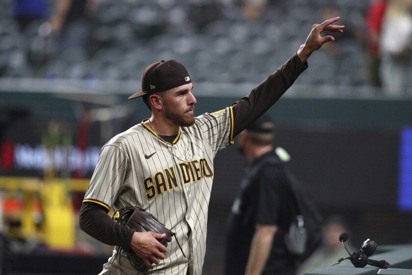 San Diego Padres starting pitcher Joe Musgrove gestures to fans after pitching a no-hitter against the Texas Rangers in a baseball game Friday, April 9, 2021, in Arlington, Texas. (AP Photo/Richard W. Rodriguez)