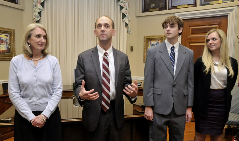 Tom Schweich, second from left, makes a few comments after his swearing-in ceremony Jan. 12, 2015, in his Capitol office in Jefferson City. At left is his wife, Kathy, and to his right are son Thomas Jr. and daughter Emile.