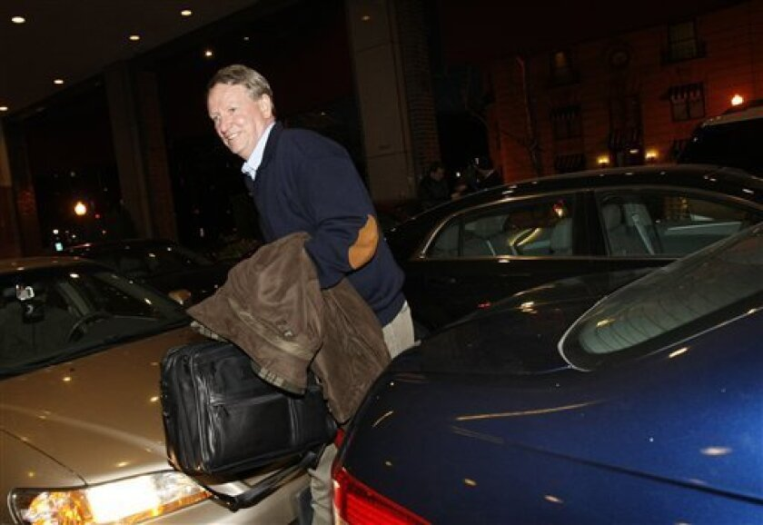 General Motors CEO Rick Wagoner, steps from a Chevrolet Malibu Hybrid car Wednesday, Dec. 3, 2008, at his hotel in Washington after driving from Detroit to testify at Congressional hearings on the auto industry bailout. If the Detroit Three automakers have learned anything since their last trip to Washington, it's that the old way of doing business just won't fly. So the decision by auto executives to travel in hybrid cars rather than corporate jets is just the start to overhauling their image as the industry pleads its case for $25 billion in federal loans. (AP Photo/Gerald Herbert)
