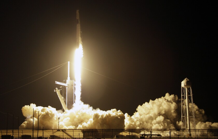A SpaceX Falcon 9 rocket with a demo Crew Dragon spacecraft lifts off from pad 39A on an uncrewed te