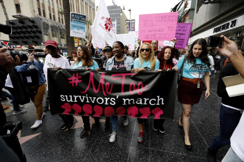 Sexual assault survivors and supporters rally down Hollywood Boulevard for the #MeToo Survivors' March against sexual abuse.