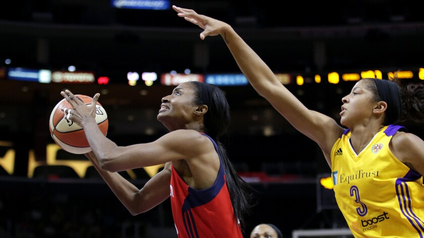 Sparks forward Candace Parker tries to block a shot by Mystics forward LaToya Sanders in the first half Thursday night at Staples Center.