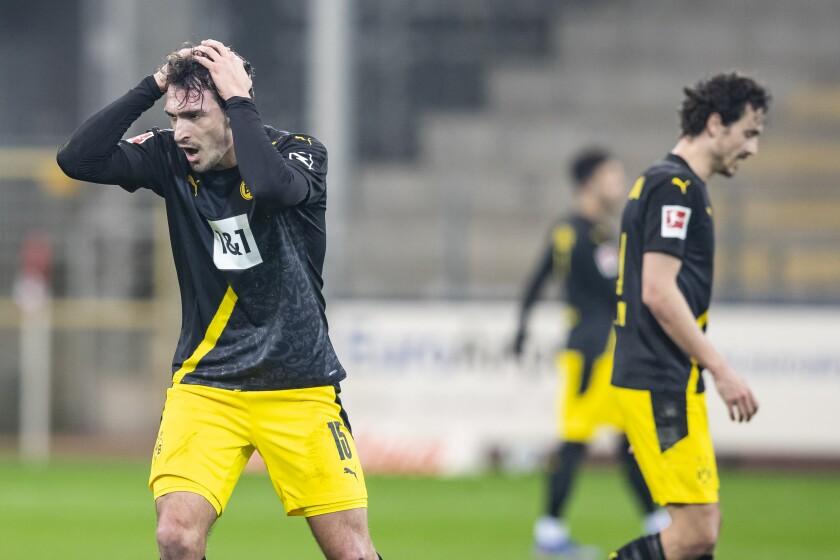 Dortmund's Mats Hummels, left, and Dortmund's Thomas Delaney react during the German Bundesliga soccer match between SC Freiburg and Borussia Dortmund in Freiburg, Germany, Saturday, Feb. 6, 2021. (Tom Weller/dpa via AP)