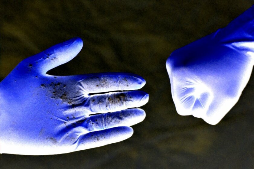 This image shows powder transferred during a handshake, to demonstrate that the custom is far less hygienic than the modern fist bump.