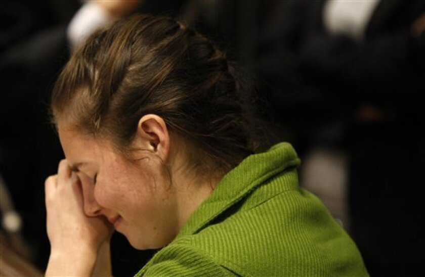 U.S. murder suspect Amanda Knox reacts during a break during the trial at the court in Perugia, Italy, Thursday, Dec.3, 2009. Lawyers for American student Knox have one last day in court to convince a jury she is innocent of the murder of her British roommate. Thursday's audience in the courtroom in Perugia is being set aside for rebuttals by prosecutors as well as by defense lawyers for Knox and her Italian former boyfriend Sollecito, who is also accused of murdering Meredith Kercher. (AP Photo/Luca Bruno)