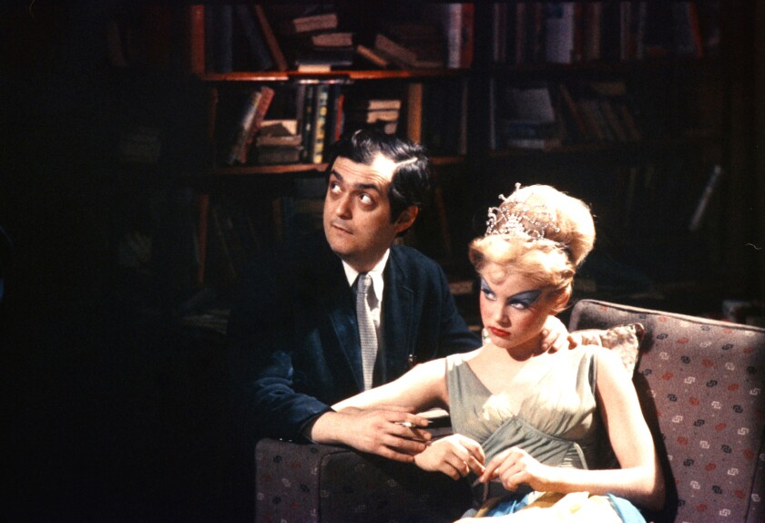 "Stanley Kubrick and Sue Lyon on the set of the movie ""Lolita."""