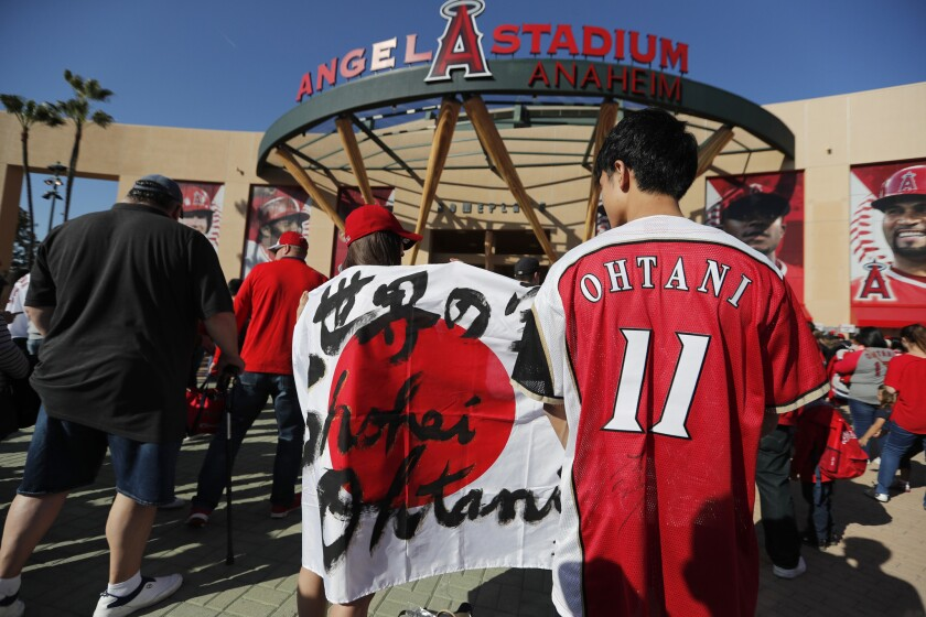 ANAHEIM, CALIF. -- TUESDAY, APRIL 17, 2018: Shohei Ohtani fan Angela Wu, center, and Takashi Hata,