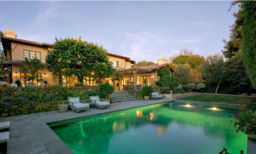 The ivy-covered home boasts a wine cellar, library and master suite with a private terrace.