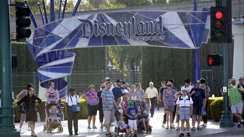 Disneyland patrons exit the theme park in 2017. The resort plays a big role in the politics of Anaheim.