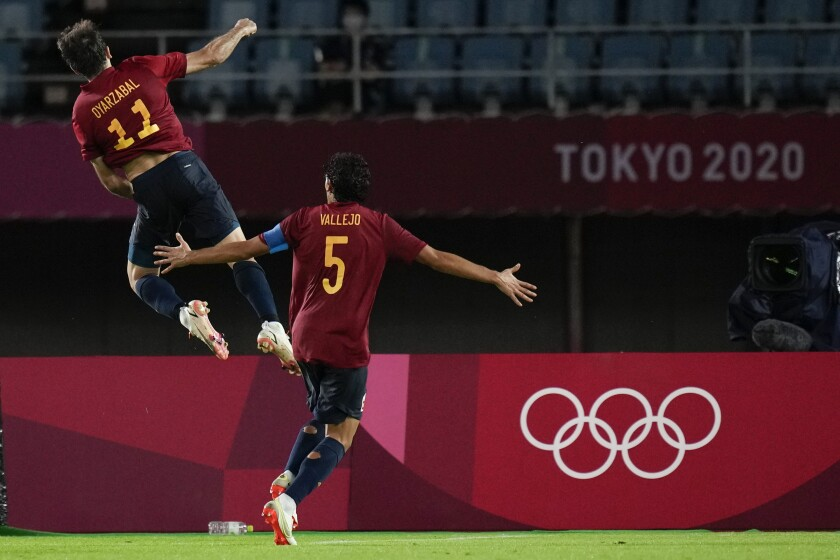 Spain's Mikel Oyarzabal celebrates scoring from the penalty spot his side's third goal against Ivory Coast