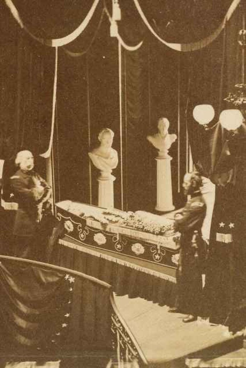 This image provided by the Abraham Lincoln Presidential Library & Museum shows a photograph of Abraham Lincoln lying in an open coffin. On Tuesday, Oct. 7, 2014, a retired historian, Ronald Rietveld, will donate to the Abraham Lincoln Presidential Library & Museum in Springfield, Ill., the original notes he took when he found the photograph. Rietveld's discovery is one of the last chapters of a story that began in April of 1865 just days after Lincoln was assassinated. In New York City, one of a number of stops the remains of Lincoln made as it made its way by train to Springfield for burial, a photographer was allowed to take a picture of the president in an open coffin. (AP Photo/Abraham Lincoln Presidential Library & Museum)