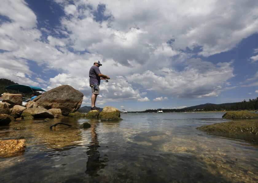 """Ventura resident Robert Hirschhorn fishes along the north shore of Big Bear Lake, not knowing that it is one of 187 reservoirs formally designated by state water regulators this year as """"mercury impaired."""""""