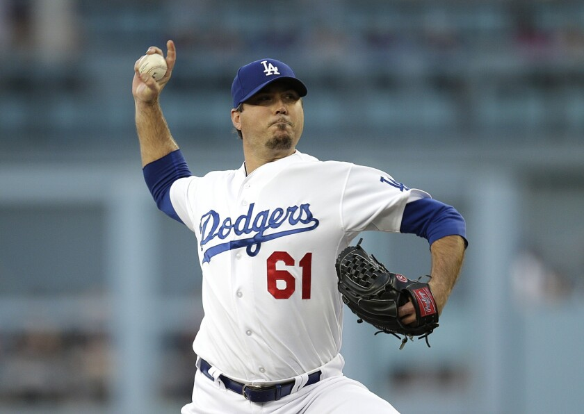 Josh Beckett got his first win of the season by limiting the Marlins to just one run on four hits while striking out six batters over the course of 6 1/3 innings.