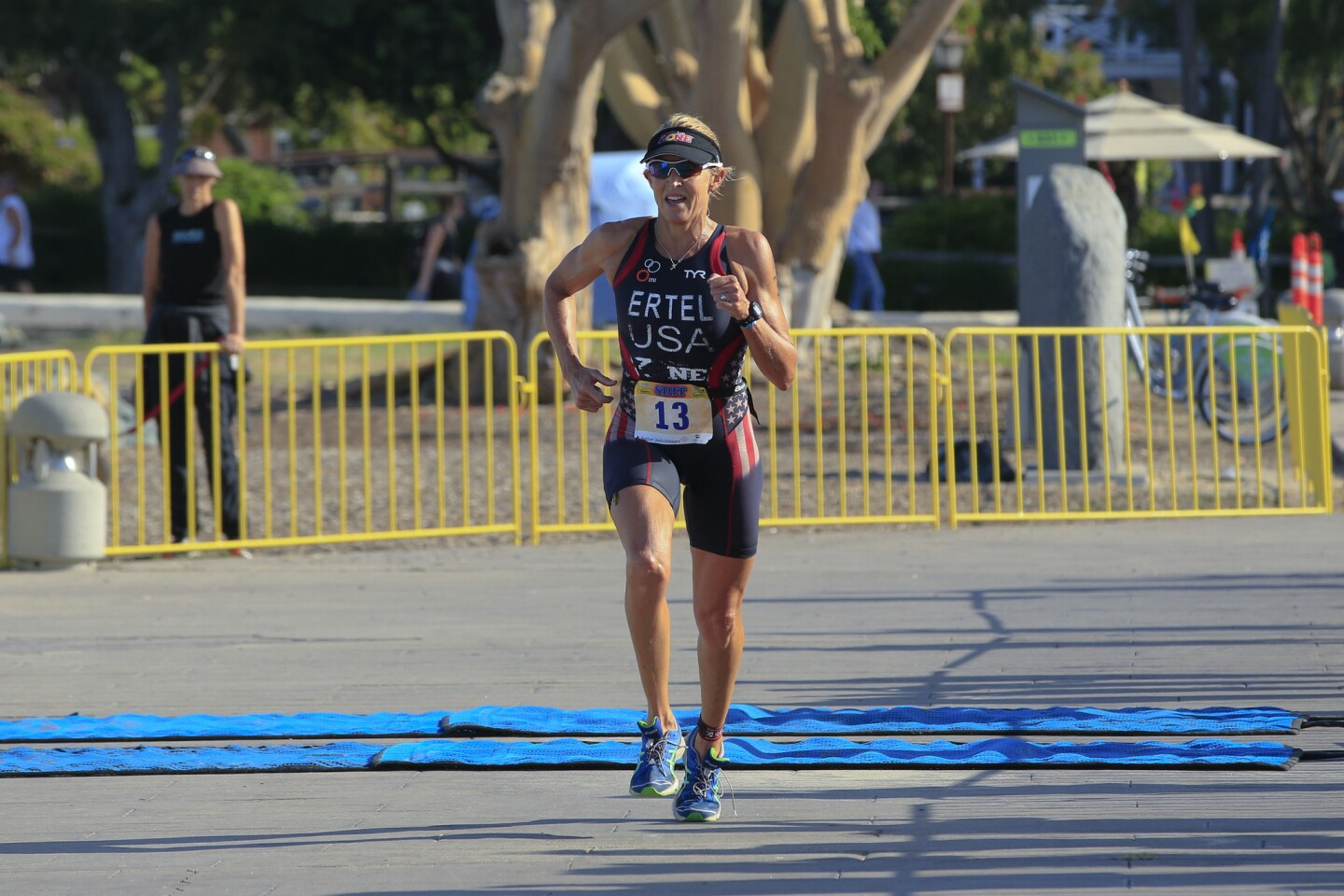 Julie Swail-Ertel comes down the final stretch towards the finish line at the Embarcadero Park to place first in the women's division at the San Diego International Triathlon on Sunday.