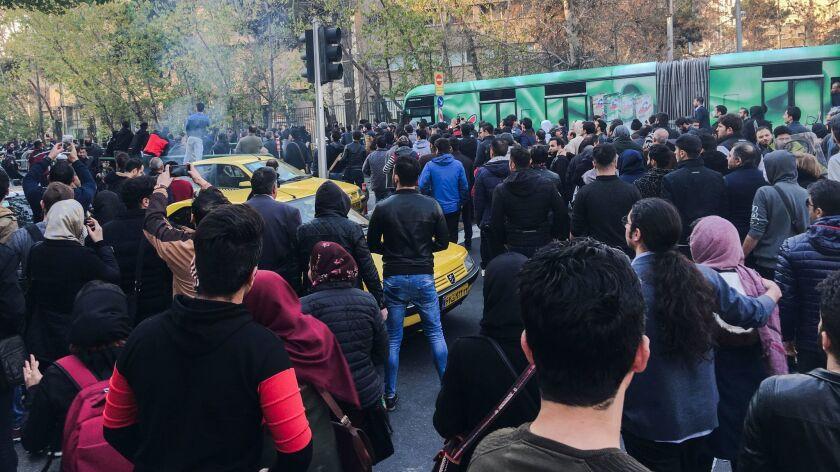 Demonstrators attend a Dec. 30, 2017, protest in Tehran over Iran's weak economy.