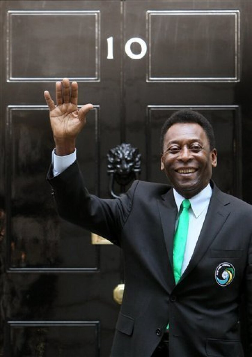 Brazilian soccer legend Pele arrives at the British Prime Minister's official London residence 10 Downing Street, where he donated a football shirt to Prime Minister David Cameron and met children involved with the Street League football charity Wednesday Aug. 3, 2011. (AP Photo/Dominic Lipinski/PA) UNITED KINGDOM OUT NO SALES NO ARCHIVE