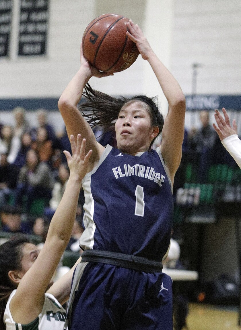 Flintridge Prep's Kaitlyn Chen drives and shoots against Providence's Sydney Sayoc in a Prep League girls' basketball game Friday at Providence.