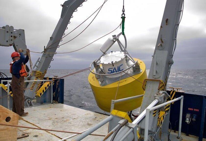 A tsunami warning buoy built by San Diego-based Science Applications  International Corp. was lowered into the Tasman Sea near Australia. (SAIC)