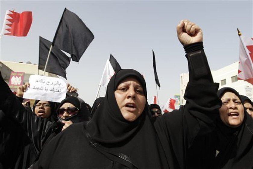 Bahraini Shiite anti-government chant anti-government slogans during the funeral of Mahmoud Maki Abu Taki, 22, who died during clashes between Bahraini anti-government protesters and riot police on Thursday, in Sitra village, Bahrain, Friday, Feb. 18, 2011.  (AP Photo/Hassan Ammar)