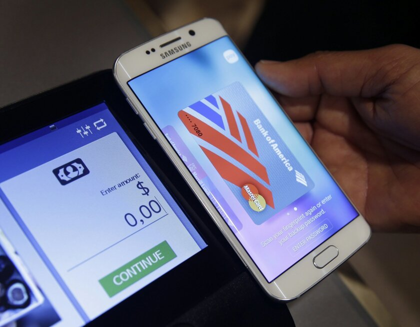 FILE - In this Aug. 6. 2015 file photo, a Samsung employee demonstrates Samsung Pay using a Galaxy S6 Edge Plus in New York. Samsung's mobile-payment service, Samsung Pay, will expand beyond the U.S. and Korea this year. The Korean company said Friday, Feb. 19, 2016, that it's coming to China in Ma