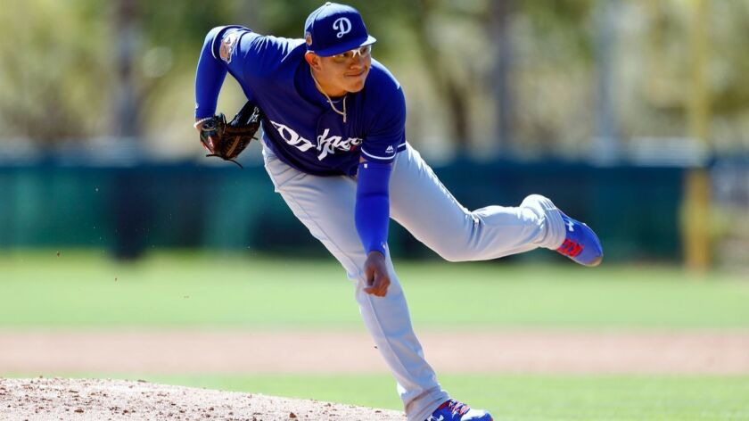 Julio Urias of the Dodgers is staying in Arizona for extended spring training to save his arm for later in the season.