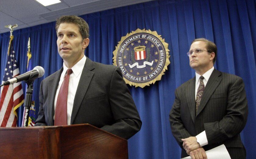 Bill Lewis, assistant agent in charge of the FBI's Los Angeles field office, right, and David Bowdich, special agent in charge of the FBI's L.A. area counterterrorism unit, discuss the arrests last month of four men suspected of promoting terrorist activities east of Los Angeles.