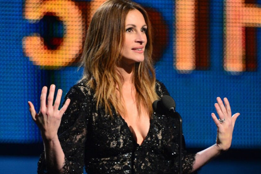 Actress Julia Roberts introduces the Beatles anniversary performance on stage for the 56th Grammy Awards at the Staples Center in Los Angeles.