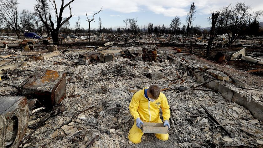 A Coffey Park man combs through the remnants of his home after the Tubbs fire swept through his neighborhood in October 2017.