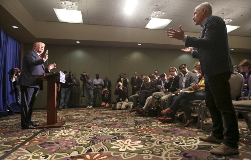 Univision journalist Jorge Ramos, right, asks Republican presidential candidate Donald Trump a question regarding immigration issues during a news conference on Tuesday, Aug. 25, 2015 in Dubuque, Iowa. (Nicki Kohl/Telegraph Herald via AP) MANDATORY CREDIT