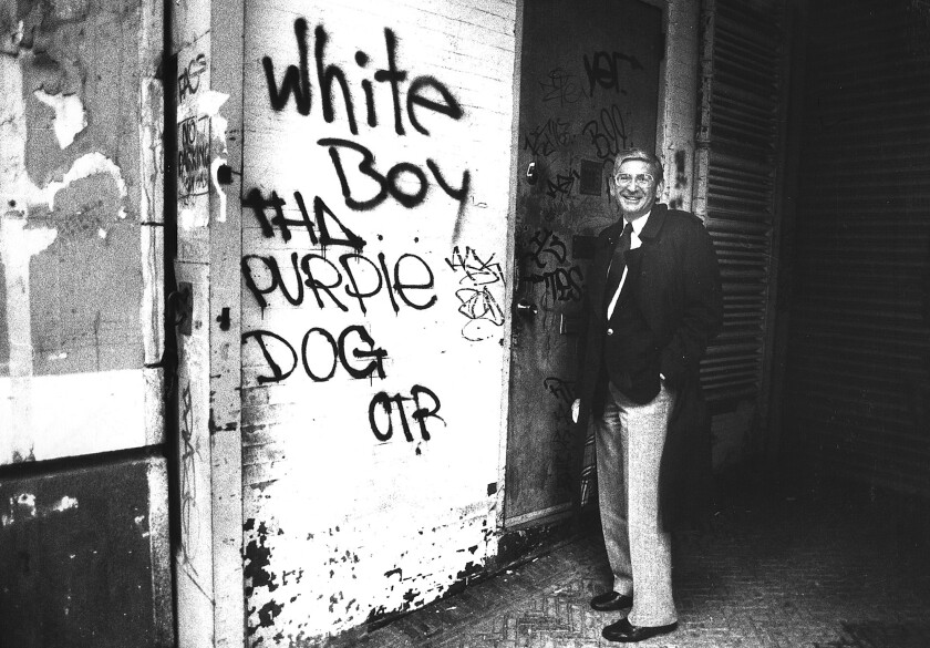Eli Broad stands next to graffiti in New York in 1986.